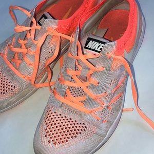 Orange Nike flyknit Training shoes